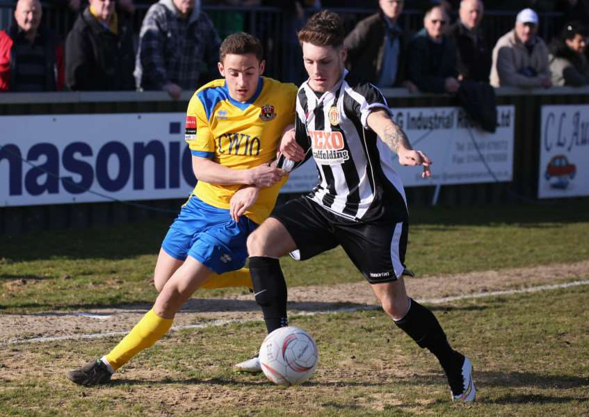 AFC Sudbury v Heybridge Swifts - Scott Kemp (left) battles with the Heybridge defender. Pic - Richard Marsham ANL-150703-203750009