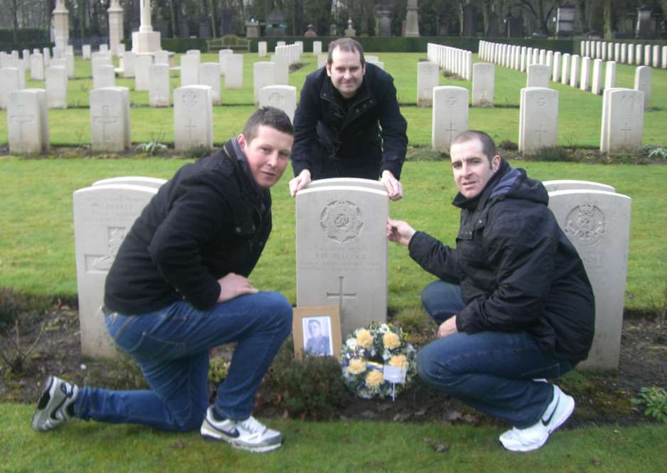 (L-R) Nathan, Gavin and Richard Alecock at the grave of their great aunt's illegitimate son Frederick Alecock, who died in the Second World War, in Evere, Belgium ANL-150225-153946001