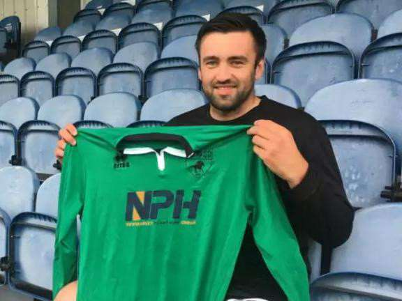 NEW KEEPER: Niall Conroy (pictured here signing for Newmarket Town) has agreed to join Haverhill Borough