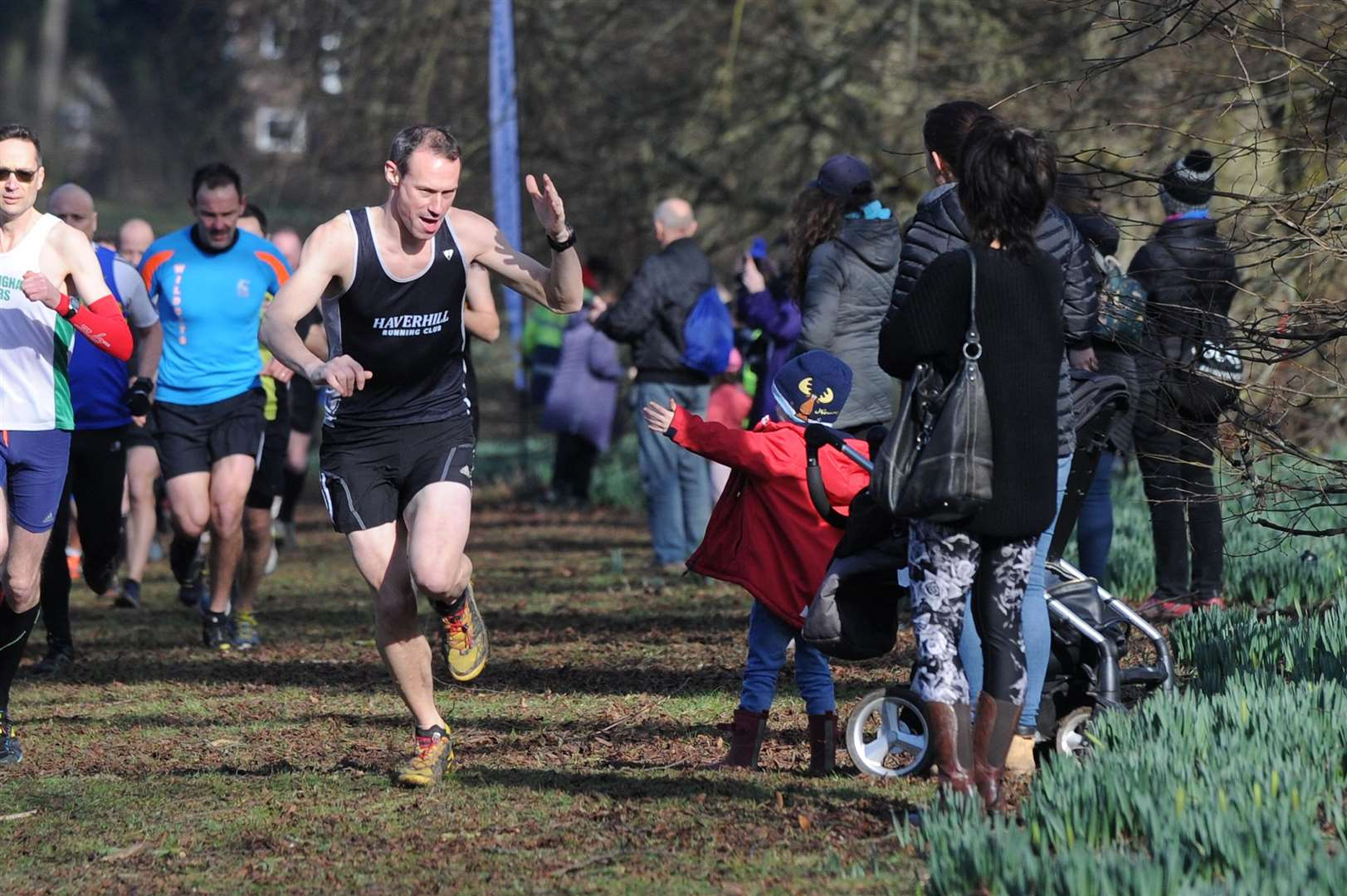 Haverhill runner Andrew Bell high-fives his son Max (main picture) on a sunny day that saw plenty of runners compete Pictures: Mecha Morton