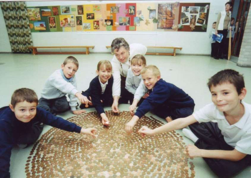 This coin spiral was created by Coupals Primary School pupils in October 2000. 4927001