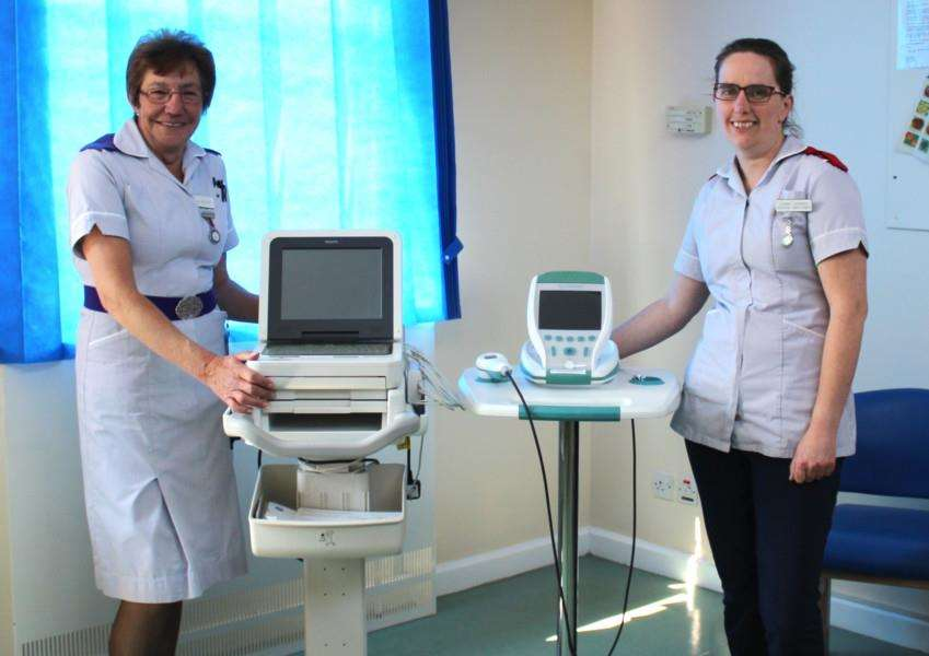 Val Woollard, nursing assistant, and Jo Hayward, assistant practitioner, at West Suffolk Hospital with an ECG machine and bladder scanner bought with legacies