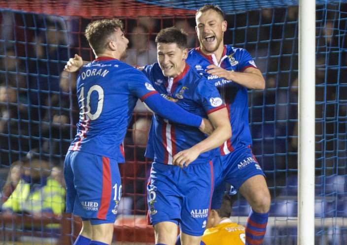 Josh Meekings, centre, celebrates his goal during Inverness Caledonian Thistle's 3-1 win over Motherwell ANL-150217-154712002
