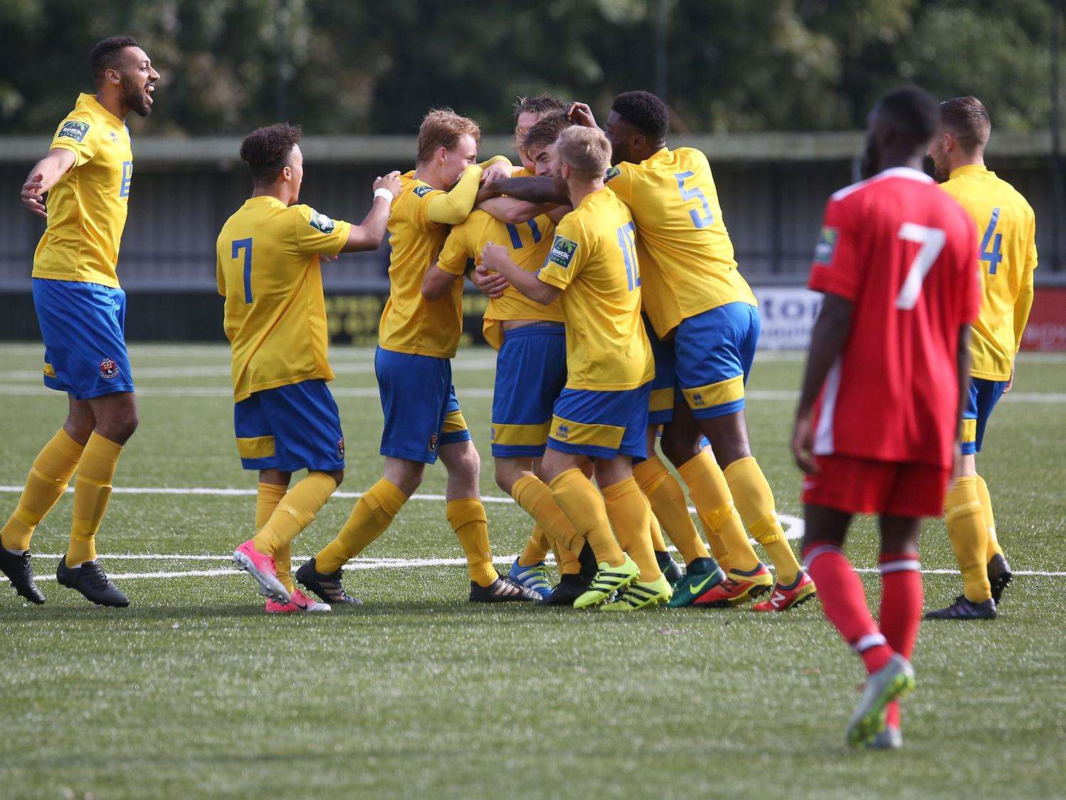 AFC Sudbury's players celebrate Adam Mills putting them into a 2-0 lead against Chipstead in the Emirates FA Cup Picture: Richard Marsham