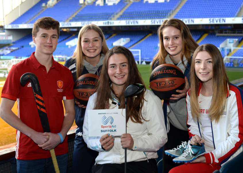 HELPING HAND: Lily May Humphreys (centre) was among the latest athletes to be recognised by SportsAid Suffolk at Ipswich Town FC Picture: SportsAid (Pagepix)