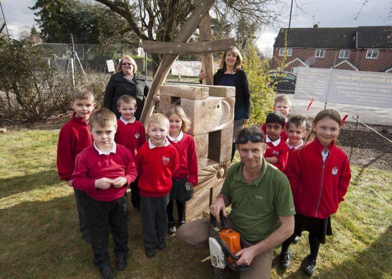 Pupils at Tollgate Primary School with sculptor Andy Manning and his work