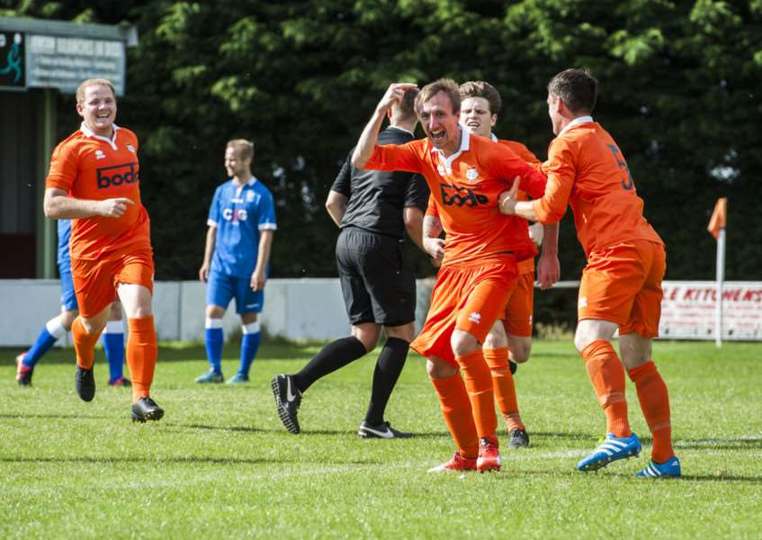 RESCUE ACT: Jason Armes wheels away after scoring a late equaliser for Diss Town.