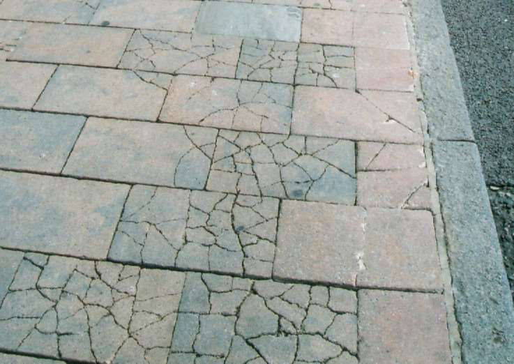 Cracked pavements outside Bury St Edmunds Post Office.Photo taken by Tom Murray who has been campaigning for improvements