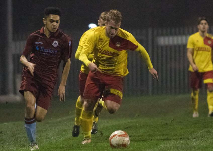 EVEN CONTEST: Walsham's Craig Nurse (right) looks to hold off a challenge from Johnny Conroy