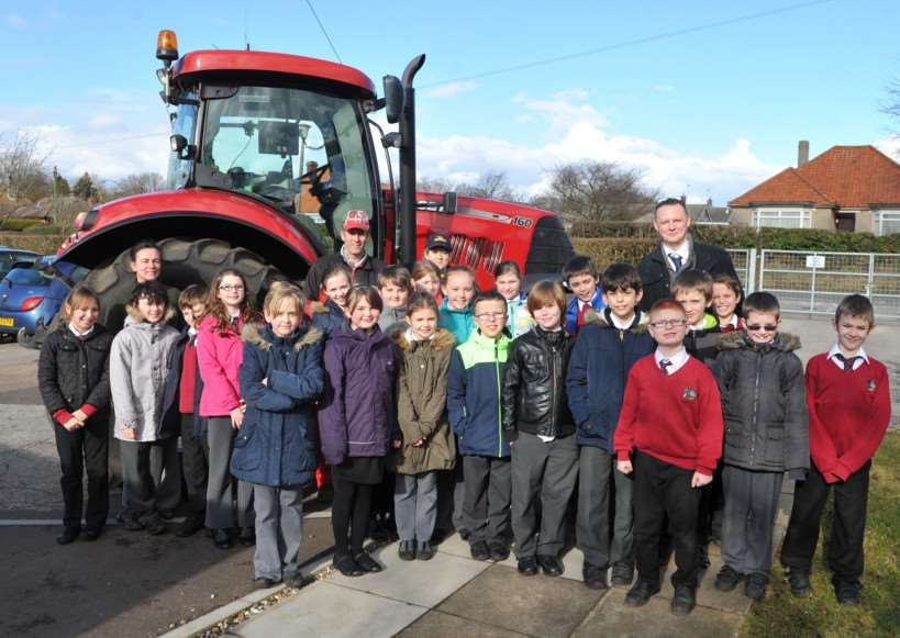 Ixworth Primary is one of the first to meet a farmer and his tractor. ANL-150224-164641009
