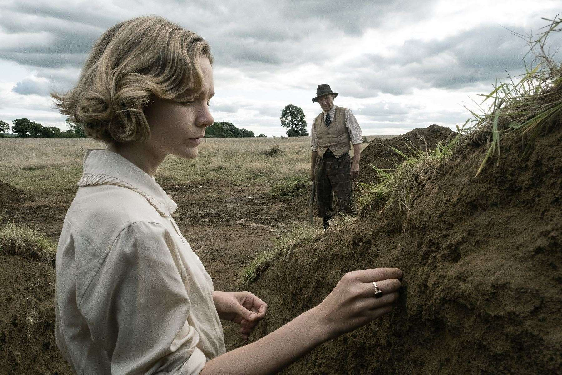 Carey Mulligan as landowner Edith Pretty and Ralph Fiennes as archaeologist Basil Brown in The Dig. Picture: Larry Horricks/Netflix