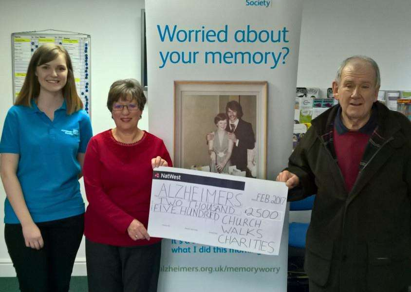Jenna Veneziani, Alzheimer's Society's community fundraiser for Norfolk & Suffolk, right, receives a cheque for �2,500 from Valerie Legg and Simon Harding of Church Walks Charities.
