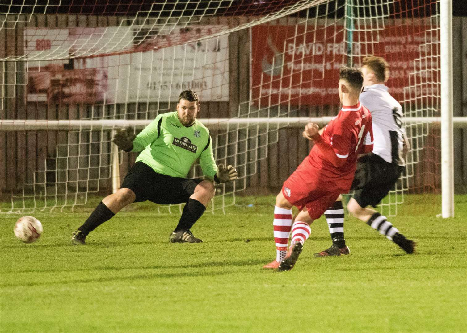 GOAL! Ely City's Alex Brown slots past Melford 'keeper Glenn Morrison during Saturday's game