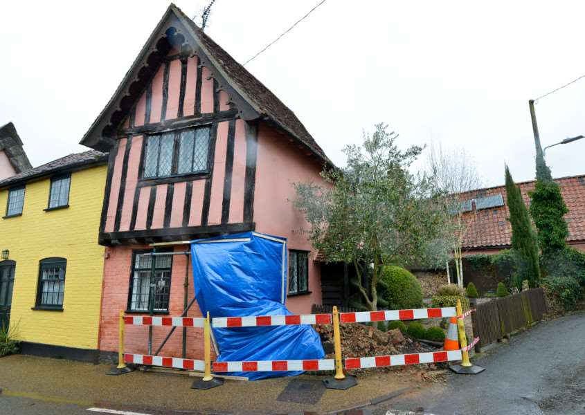 Villagers fear increased traffic through Woolpit could harm its historic centre. This house was hit by a lorry last September.