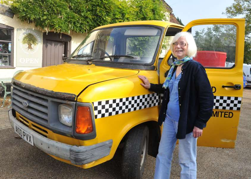 Woolpit Green Fair.''Pictured: Jean Aldous next to her pioneering hybrid car. In 1973, she set off from London to Paris in a early hybrid car - a ford escort with a petrol lawnmower/electric motor engine. The engine has now been installed in a Transit van. ANL-150510-075211009