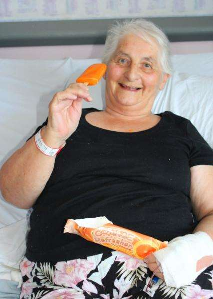 Patient Viv Arnold tucks into her ice lolly ANL-160719-163816001