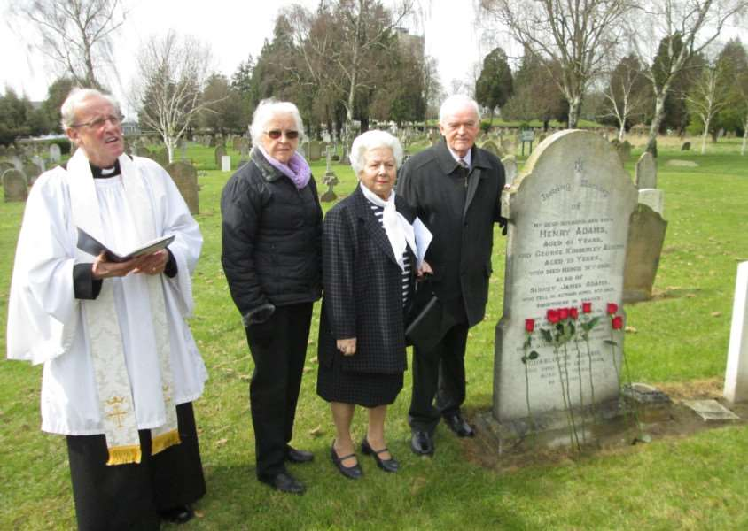 As the Rev Mark Hunt calls for a minute's silence, Reg Adams stands beside his grandfather Henry Adams' grave with his wife Silvia, centre, and sister Patricia ANL-160104-162739001