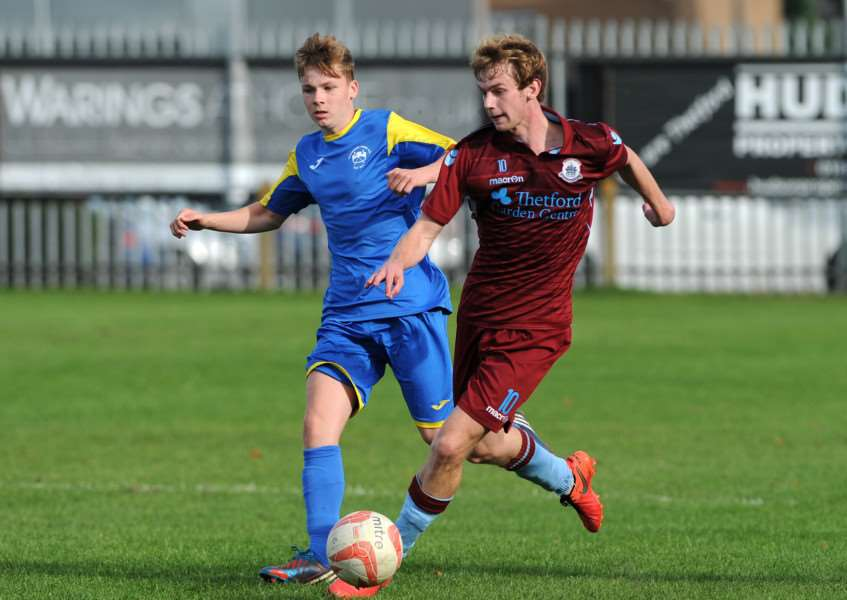 TARGET MAN: Thetford midfielder Cameron King, right, is attracting the attention of scouts