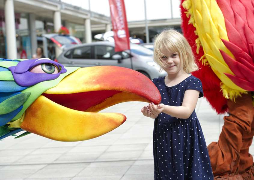 Four-year-old Isabelle Roskilly makes friends with one of the bird puppets