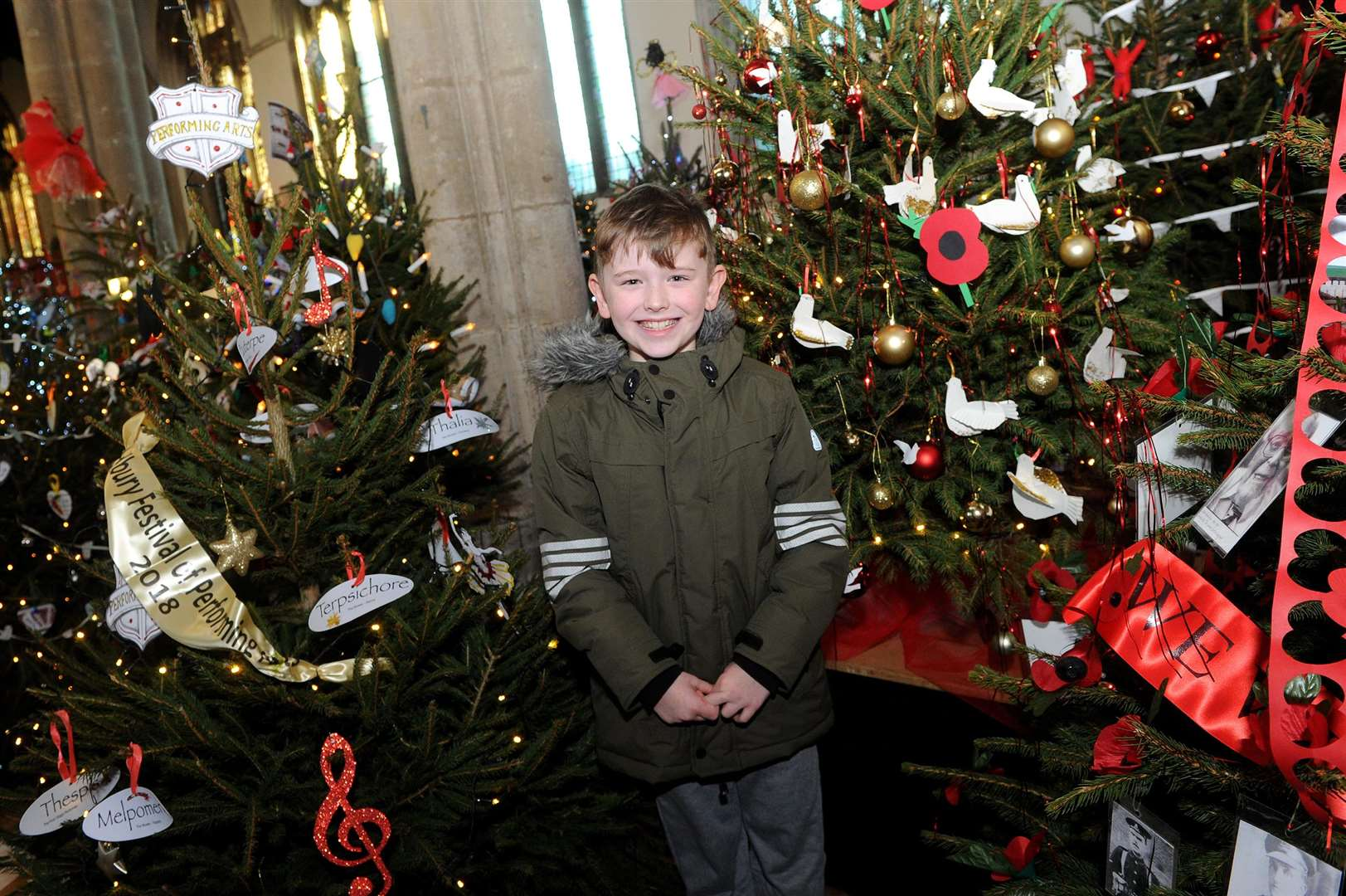A Christmas tree festival has been staged at St Peter's, organised by Sudbury Rotary Club...Pictured: Joshua Bottomless (9) from Cavendish with the Primary Schools tree...PICTURE: Mecha Morton. (5877118)