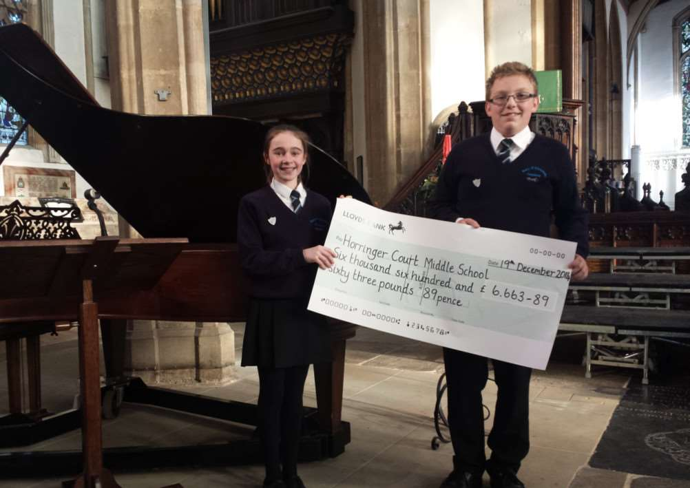 Head Girl Ella Bell and Head Boy Jack Warboys with Horringer Court Middle School's charity cheque for �6,663.89 ANL-141222-151640001