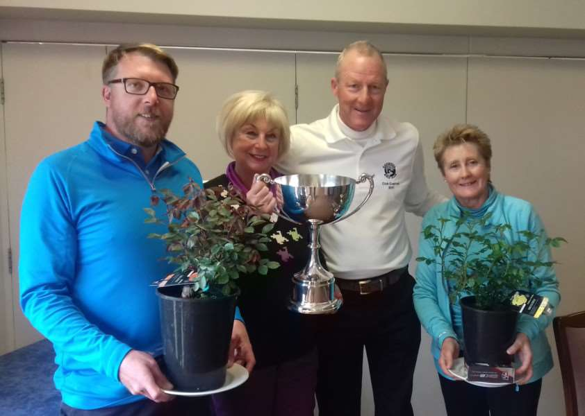 TROPHY WINNERS: Scott Turner and Christine Grainger with club captains' Andrew and Lindsey Cornish