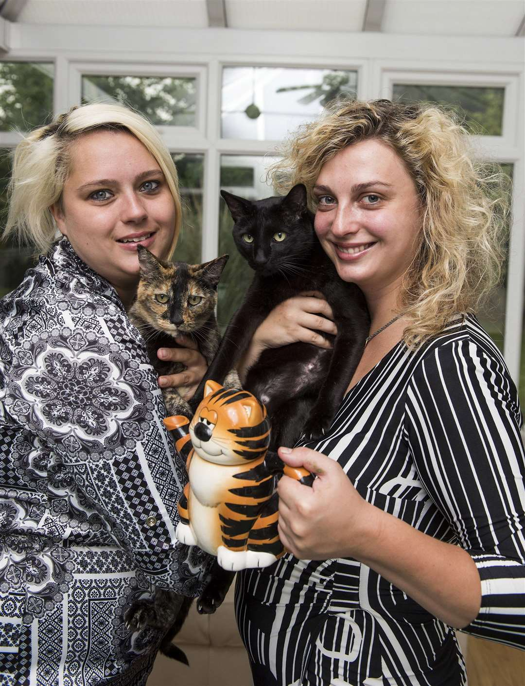 ..Gemma and Lauren (right)who are setting up the cat cafe...Cats are Mease and Rome the black one..Picture Mark Westley. (5119390)
