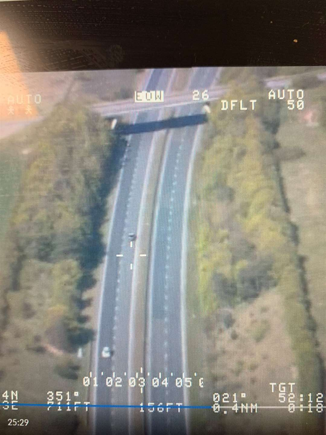 Cambridgeshire Police released an image from the national air service of the BMW driving at 150mph on the A11