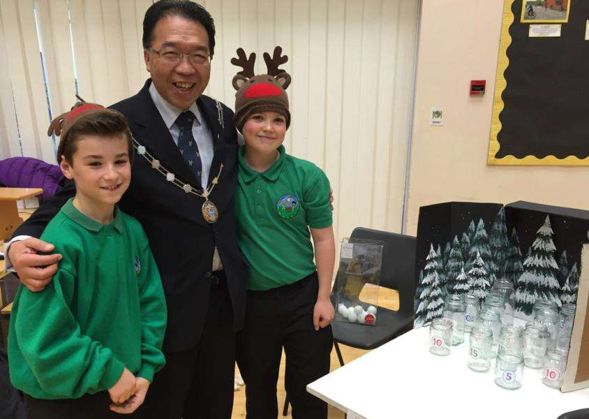 St Edmundsbury's Mayor Patrick Chung with pupils Callum Ranson and Jake Beadle-Newman who were manning a stall ANL-150912-171652001