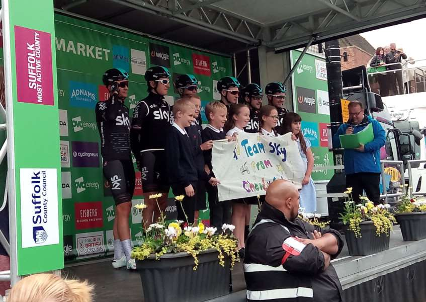 Pupils from Cheveley Primary School presented Team Sky riders with a banner