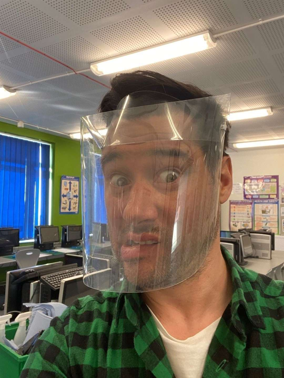 Stour Valley Community School DT teacher Dan Stephens wearing one of the face shields made in the school. Contributed picture (34949481)