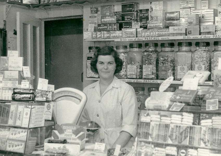 Doreen Tilley behind the counter at her tobacconist and confectioners in Whiting Street in 1950.