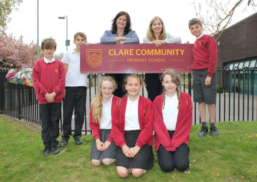 Stour Valley Community School head teacher Christine Inchley, left, with Clare Community Primary School head teacher Rebecca Loader, right, and pupils from the primary school.