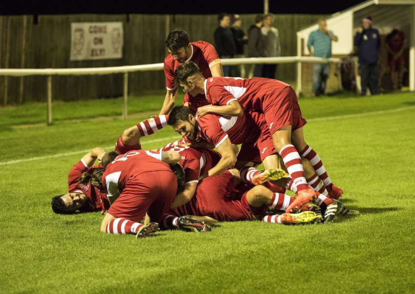 LATE EQUALISER: Sam Reed is mobbed after drawing Ely level