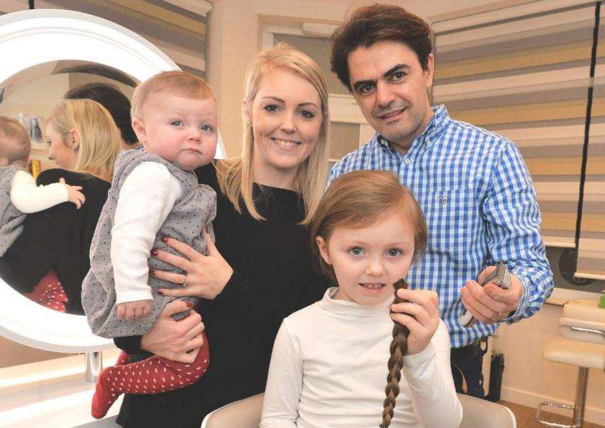 Mary-May Fenton with hairdresser Toni Saade, mum Steph and baby sister Clara. Picture: Geoffrey Pieters