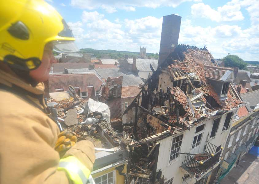 A fireman looking down on the wreckage of Cupola House the day after the fire in June 2012