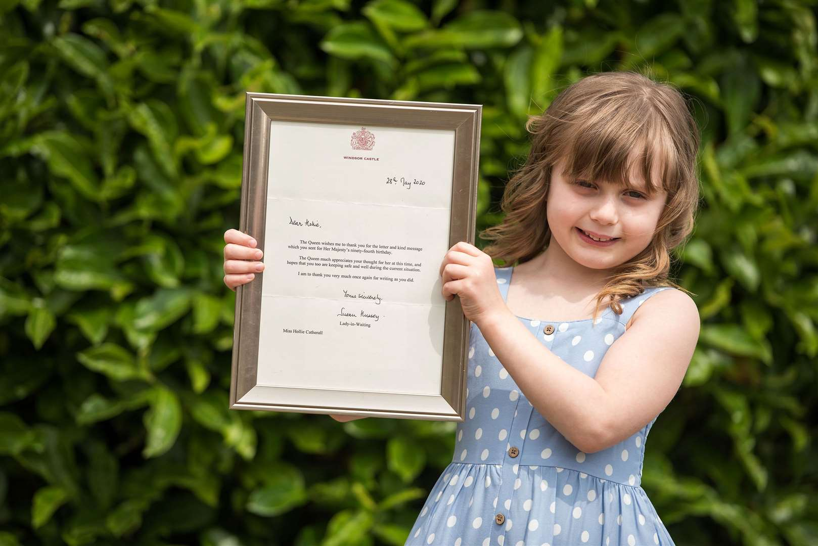 ONEHOUSE: Hollie Catherall has received a letter from the Queen.Hollie Catherall, six, received a reply from a letter she sent to the Queen..Hollie with her dad, Aaron. Picture by Mark Westley. (35925374)