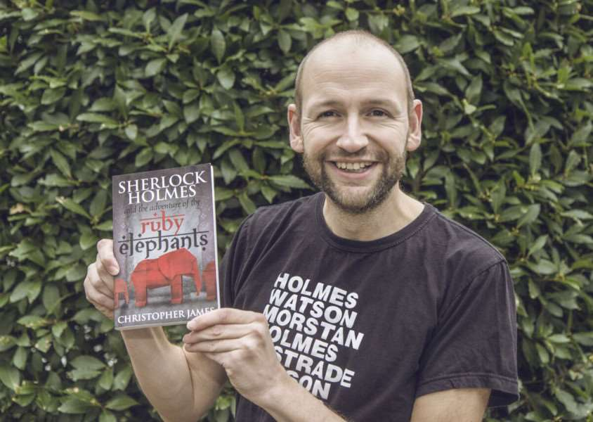 Author Christopher James with his debut full-length novel, Sherlock Holmes and the adventure of the ruby elephants ANL-151117-160922001