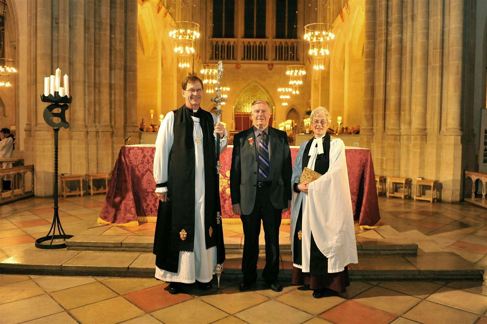 Horry Parsons pictured in 2012 receiving the order of St Edmund at St Edmundsbury Cathedral with The Right Rev Nigel Stock and Very Rev Dr Frances Ward