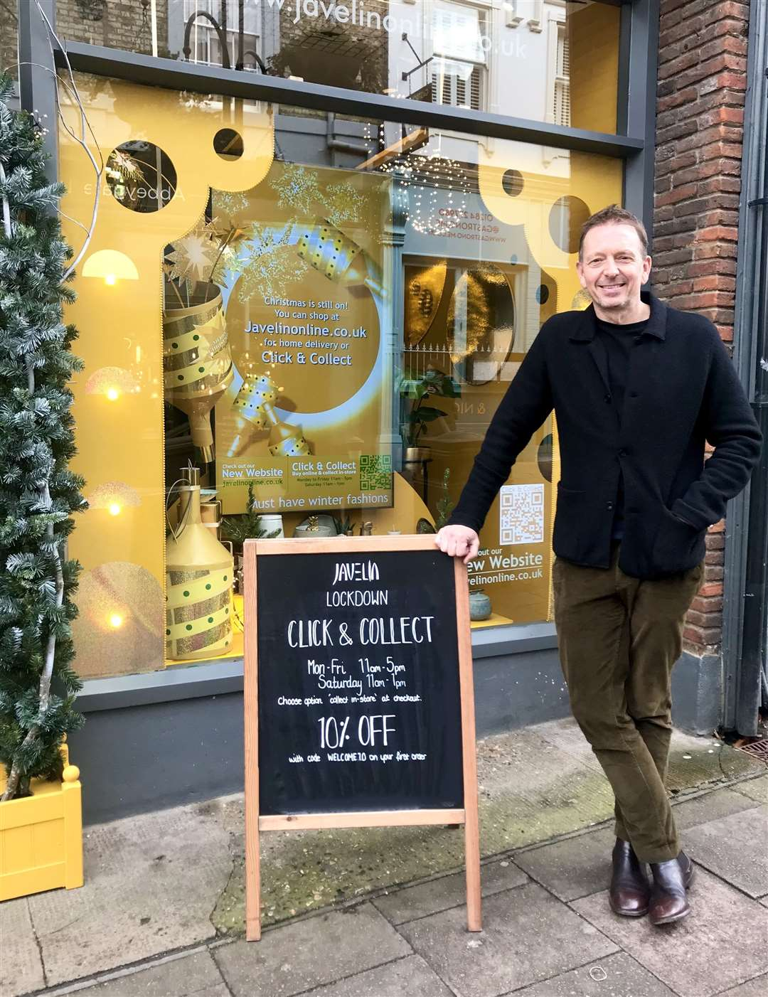 Jeremy Clayton, owner of Javelin, with the Bury St Edmunds shop's Christmas window display