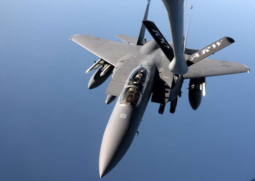 An F-15E Strike Eagle from the 48th Fighter Wing approaches a KC-135 Stratotanker from the 100th Air Refueling Wing for refueling over the northern Mediterranean.'(USAF photo by Senior Airman Kate Thornton) ANL-151116-101926001