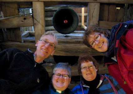 PCC member Justin Rabett, Rev Cheryl Collins, Churchwarden Jill Upton and PCC member Jill de Laat under the newly restored bell at St Edmunds Church, in Hargrave. ANL-141222-105542001