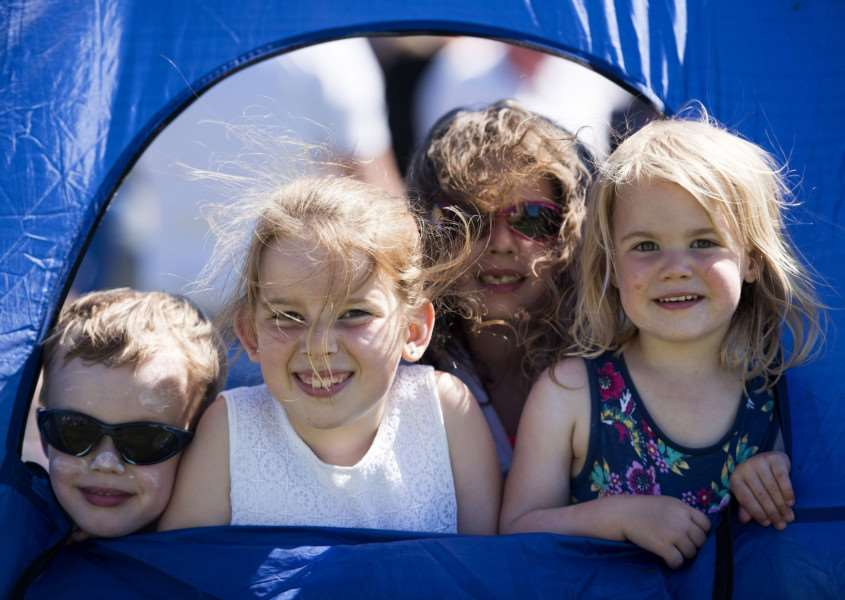 Leestock'Melford Hall, Long Melford, Sudbury'Harrison, Lily, Scarlett and Millie hide from the sun in a tent'Pictures Mark Westley
