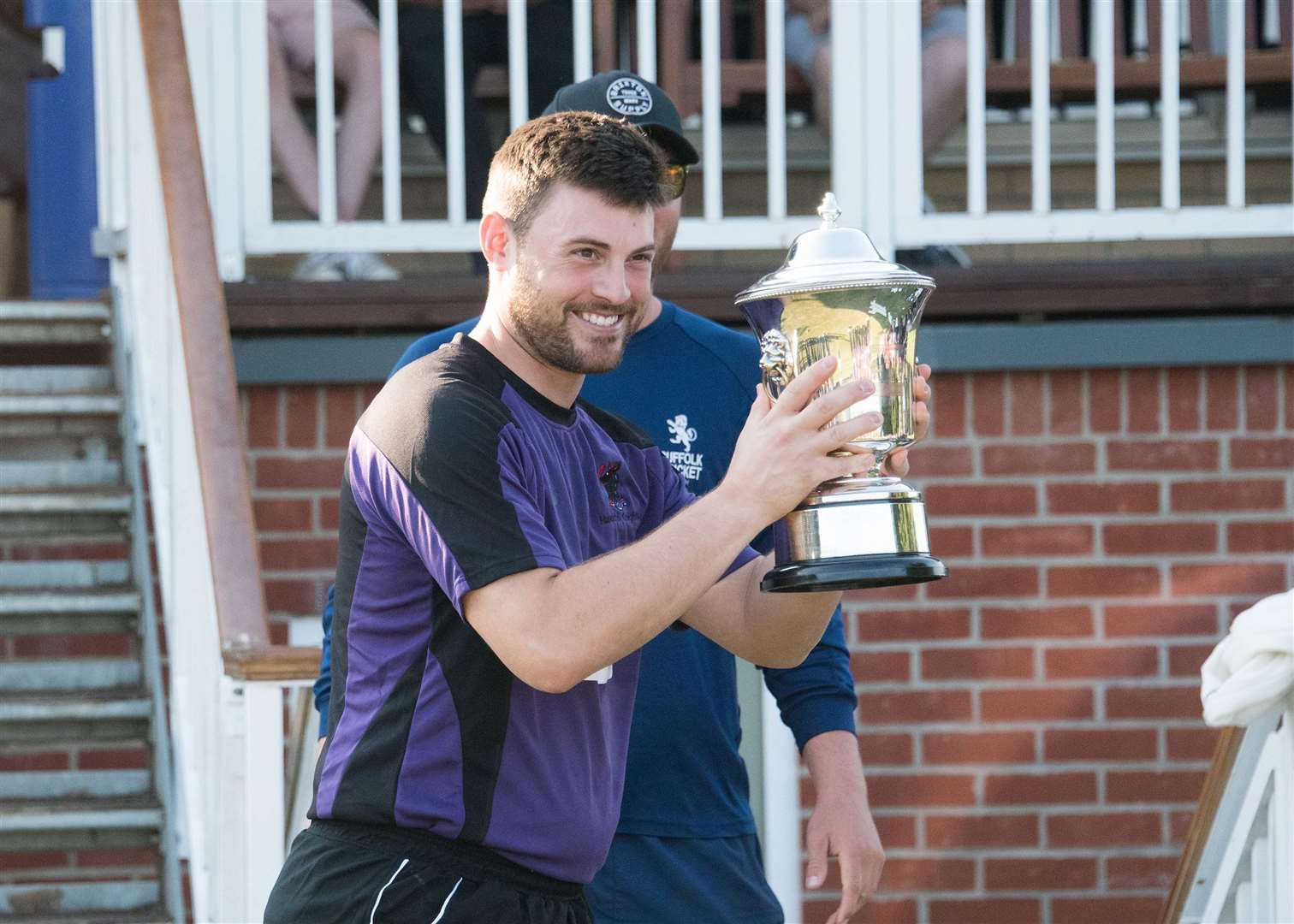 Haverhill winners of the Suffolk Cup T20 Finals Day Dave Humphrey (captain collecting the trophy from Alfie Marston) Picture Mark Westley. (3942144)