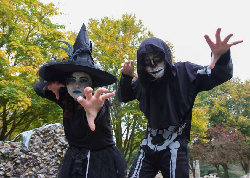 Halloween extravaganza is being played out in the Abbey Gardens alongside a Ghostly and Macabre tour of Bury St Edmunds'West Suffolk College students Ryan Adams, 17, and Anna Payne, 16 get in the mood for ghostly goings on,