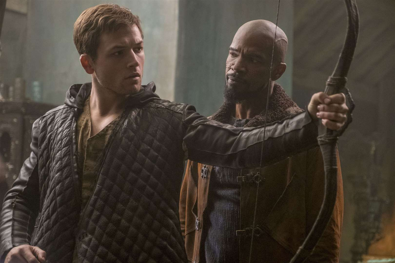 Taron Egerton as Robin and Jamie Foxx as John in Robin Hood. Picture; PA Photo/Lionsgate Films/Larry Horricks.
