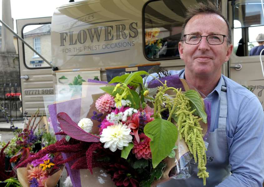 Clare, Suffolk. Clare's monthly market returns after an absence of 20 years. Pictured is Jamie Spencer of Mr Spencer's Flowers.''Picture: MARK BULLIMORE