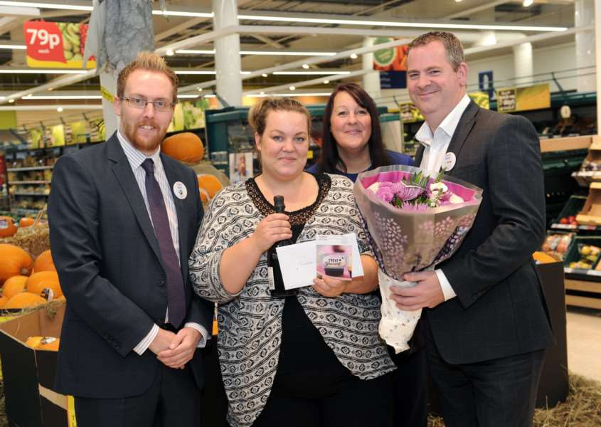 Tesco Superstore thanks Madison Dodds, who helped out elderly shopper.''Pictured: Sam Arnolds (Customer Experience Manager), Madison Dodds, Mel Edwards (Community Champion) and Mark Smaldon (General Manager) ANL-161017-185946009
