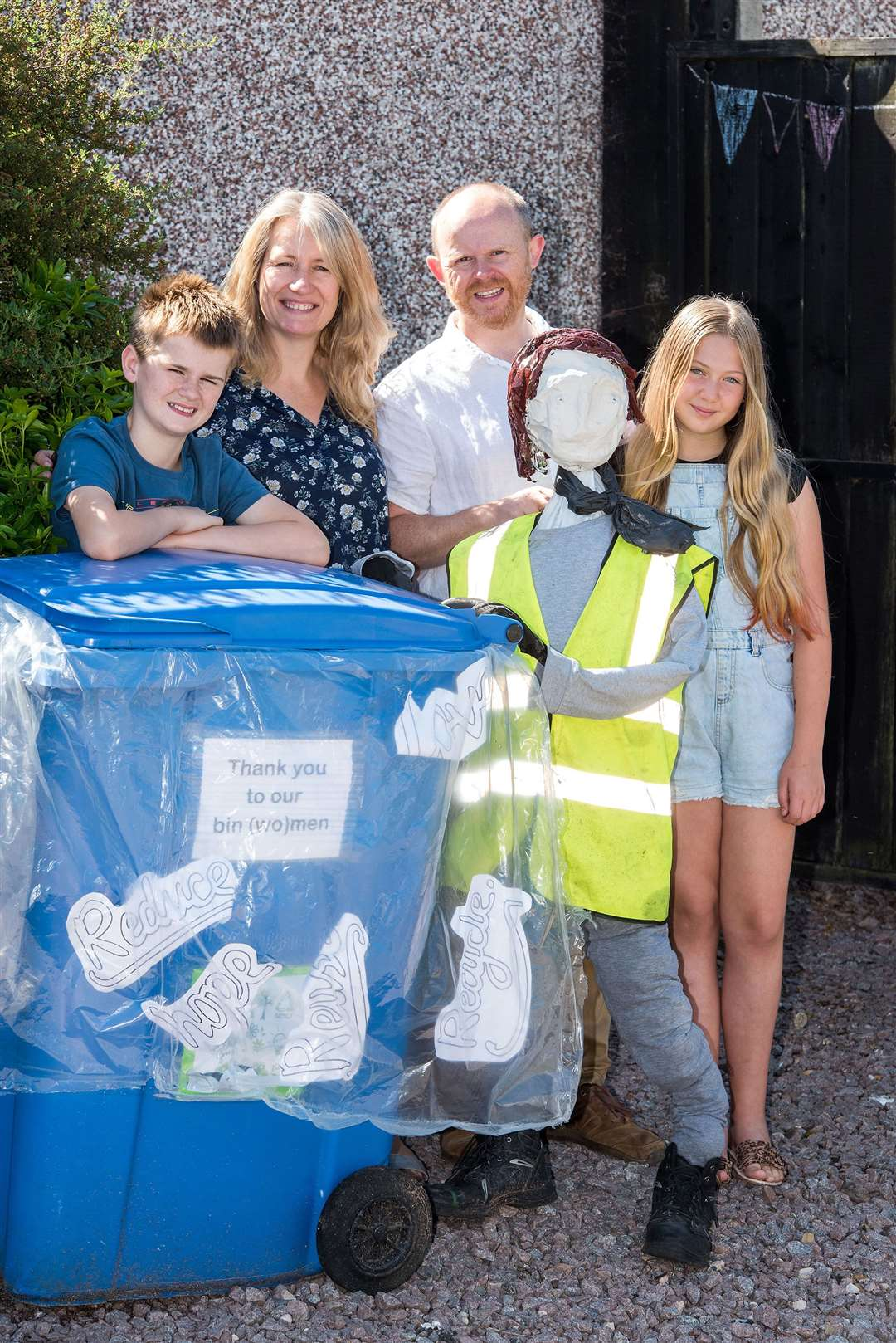 Ketton Scarecrow organisers Matt and Liz Garwood with their children William and Hannah and Beryl the bin woman. Picture by Mark Westley