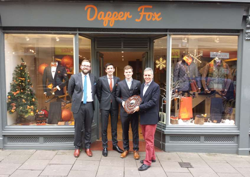 James Rudd, Tom Betts and Elliot Gaywood of Dapper Fox are presented with their winning Christmas window shield by Mark Cordell of Ou Bury St Edmunds ANL-151217-165355001